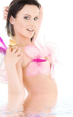lovely naked girl with butterflies in water Stock Photo - 4118812