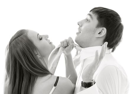 conflicting: monochrome picture of conflicting couple over white