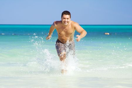 tanned man running out of the ocean Stock Photo - 4222498
