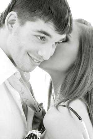 secret love: monochrome picture of couple in love over white