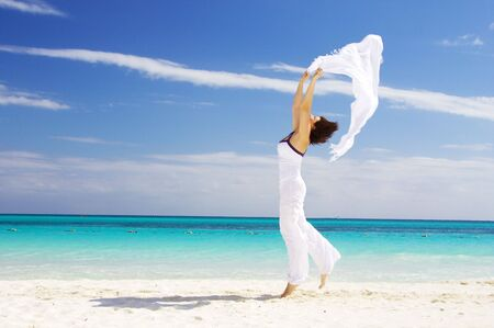 happy woman with white sarong on the beach Stock Photo - 4222504