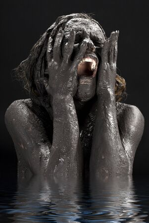 naked black women: picture of crying dirty woman in water LANG_EVOIMAGES