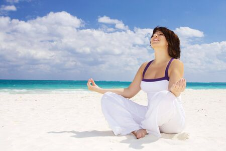 meditation of happy woman in lotus pose on the beach Stock Photo - 4270288