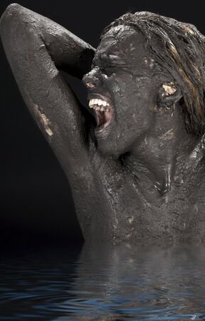 mud woman: picture of crying dirty woman in water LANG_EVOIMAGES