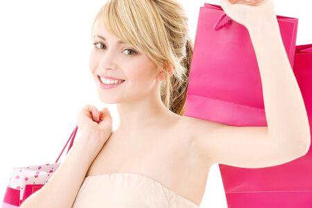 feliz adolescente rosa con bolsas de la compra Foto de archivo - 4303485