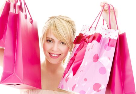 happy teenage girl with pink shopping bags Stock Photo - 4303484
