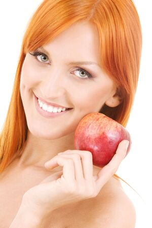 redhead woman with red apple over white Stock Photo - 4303486
