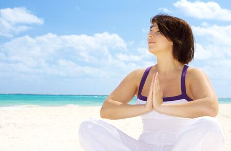 meditation of happy woman in lotus pose on the beach Stock Photo - 4349317