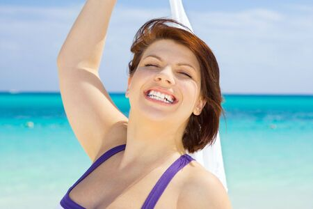 happy woman with white sarong on the beach Stock Photo - 4367286