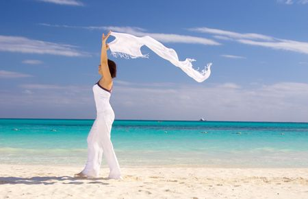 happy woman with white sarong on the beach Stock Photo - 4367287