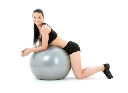 lovely fitness instructor with pilates ball Stock Photo - 4367290