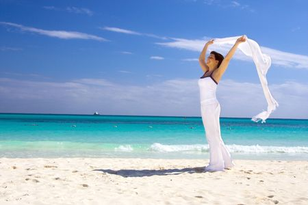 happy woman with white sarong on the beach Stock Photo - 4376553