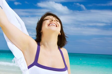 happy woman with white sarong on the beach Stock Photo - 4387672