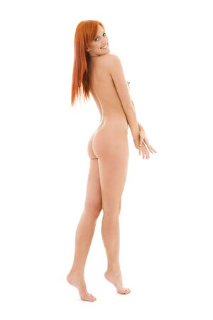 nude woman standing: bright picture of healthy naked redhead over white