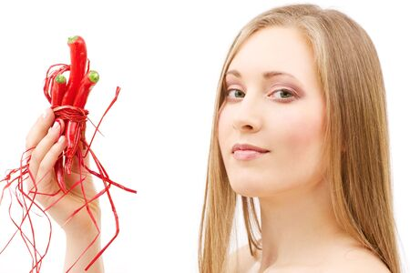 picture of lovely woman with hot chili peppers Stock Photo - 4387675