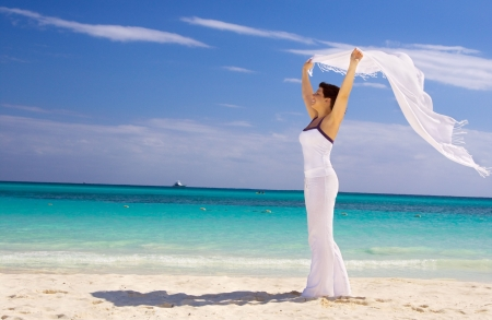 happy woman with white sarong on the beach Stock Photo - 4397007