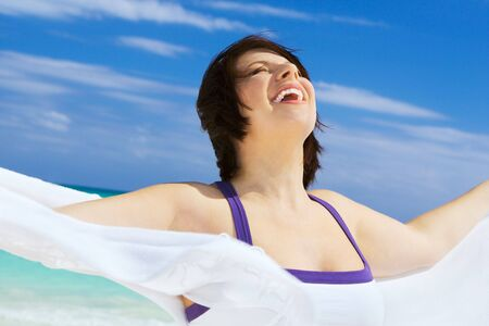 happy woman with white sarong on the beach Stock Photo - 4397006
