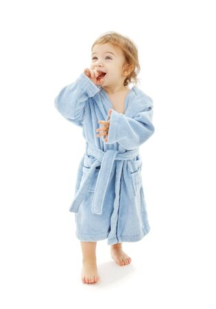 toddler walking: baby boy in blue robe over white