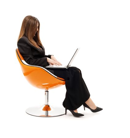 businesswoman in chair with laptop computer over white Stock Photo - 4397011