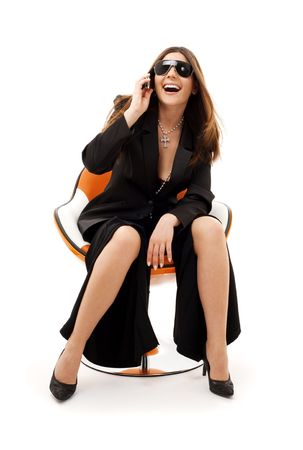 businesswoman with phone in orange chair over white Stock Photo - 4397002