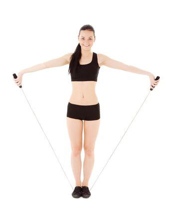 adorable instructor de fitness con saltar la cuerda más de blanco Foto de archivo - 4405788