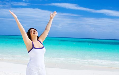 happy woman with raised hands on the beach Stock Photo - 4405794