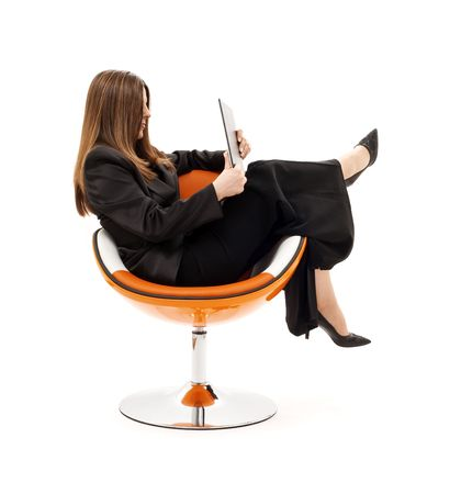 businesswoman in chair with laptop computer over white Stock Photo - 4405783