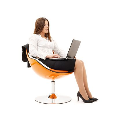 businesswoman in chair with laptop computer over white Stock Photo - 4405785
