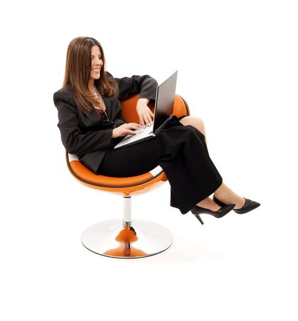 businesswoman in chair with laptop computer over white Stock Photo - 4413791