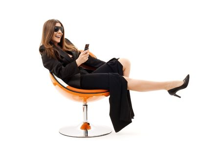 businesswoman with phone in orange chair over white Stock Photo - 4421400