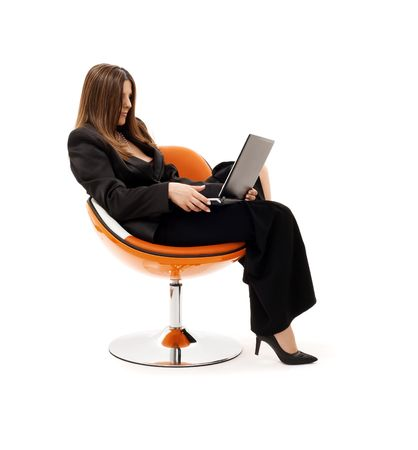 businesswoman in chair with laptop computer over white Stock Photo - 4421399