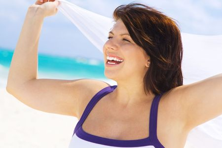 happy woman with white sarong on the beach Stock Photo - 4439147