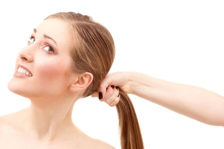 lovely woman face and female hand pulling her hair Stock Photo - 4439134