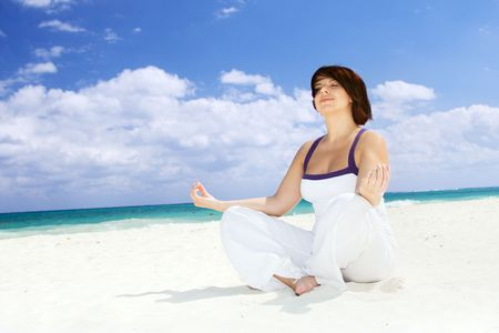meditation of happy woman in lotus pose on the beach Stock Photo - 4439158