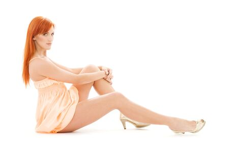 leggy: picture of tall redhead woman over white