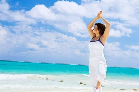 meditation of happy woman on the beach Stock Photo - 4439187