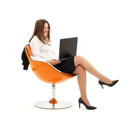 businesswoman in chair with laptop computer over white Stock Photo - 4439179