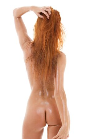 nude butt: picture of healthy naked redhead over white LANG_EVOIMAGES