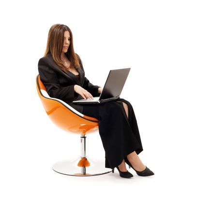 businesswoman in chair with laptop computer over white Stock Photo - 4463355
