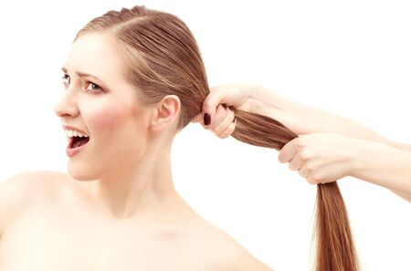 pulling hair: lovely woman face and female hands pulling her hair