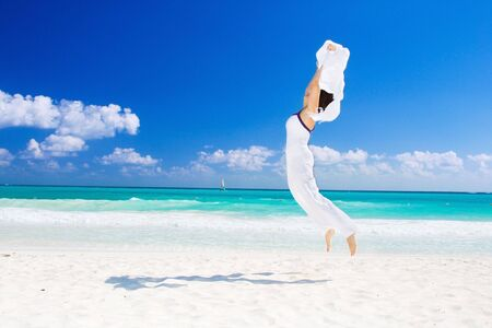 happy woman with white sarong on the beach Stock Photo - 4470497