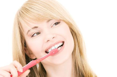perfect teeth: picture of happy girl with toothbrush over white