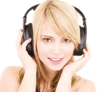 girl headphones: happy teenage girl in headphones over white