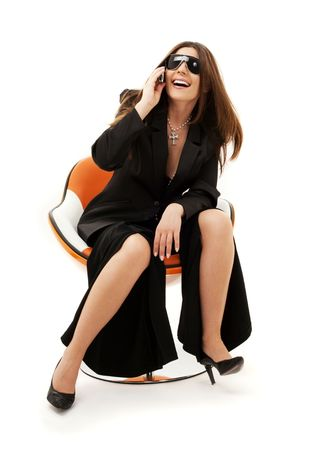 businesswoman with phone in orange chair over white Stock Photo - 4480374