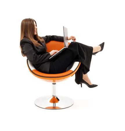 businesswoman in chair with laptop computer over white Stock Photo - 4488493