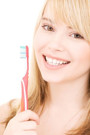 dental smile: picture of happy girl with toothbrush over white