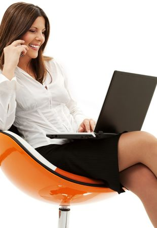 businesswoman in chair with laptop and phone over white Stock Photo - 4496046