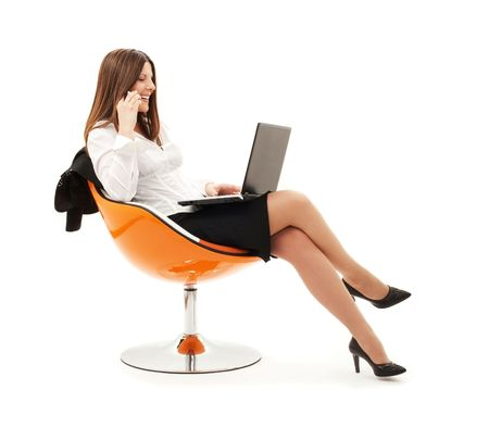 calling communication: businesswoman in chair with laptop and phone over white LANG_EVOIMAGES