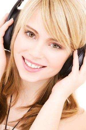 happy teenage girl in headphones over white Stock Photo - 4496055