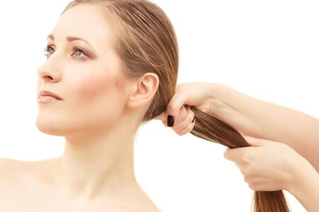 lovely woman face and female hand pulling her hair Stock Photo - 4505110